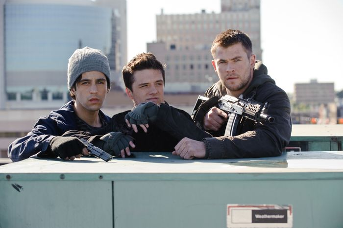 "Josh Peck (left), Josh Hutcherson (center) and Chris Hemsworth star in ""Red Dawn."" (Associated Press/Film District)"