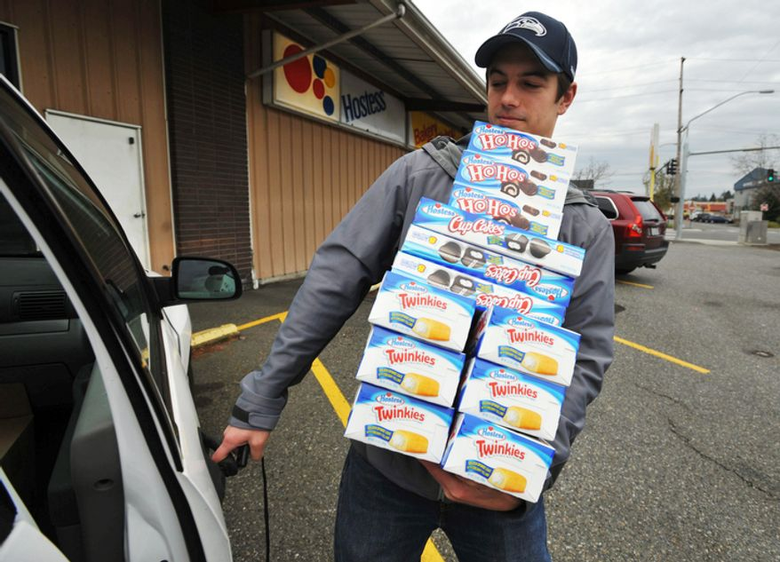 Andy Wagar loads Twinkies, Ho-Hos and Cup Cakes into a van outside the Wonder Bakery Thrift Shop in Bellingham, Wash., on Nov. 16, 2012, after Hostess Brands Inc. said it would shutter is operations after years of struggling with management turmoil, rising labor costs and the ever-changing tastes of Americans. (Assocated Press/The Bellingham Herald)