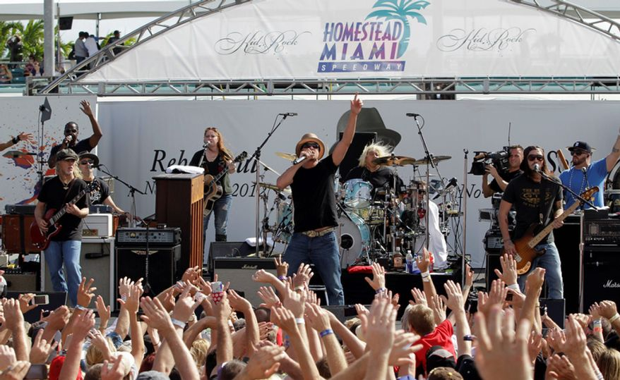 **FILE** Kid Rock (center) performs during a concert before the NASCAR Sprint Cup Series championship race at Homestead-Miami Speedway in Homestead, Fla., on Nov. 18, 2012. (Associated Press)