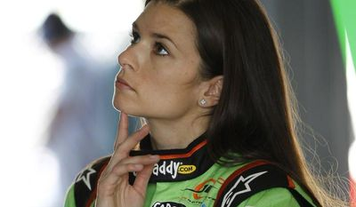 Driver Danica Patrick stares at a computer monitor as her team prepares for Saturday's NASCAR Nationwide auto race, Friday, Nov. 16, 2012 at the Miami-Homestead Speedway in Homestead, Fla. (AP Photo/Terry Renna)
