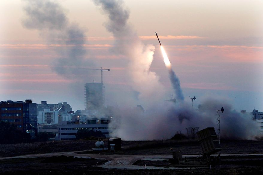 **FILE** The Iron Dome defense system fires to intercept incoming missiles from Gaza in the port town of Ashdod on Nov. 15, 2012. (Associated Press)