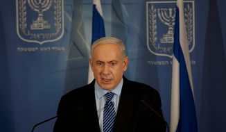 **FILE** Israeli Prime Minister Benjamin Netanyahu delivers a statement to the media at Hakirya military base in Tel Aviv on Nov. 14, 2012. (Associated Press)