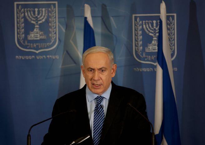 **FILE** Israeli Prime Minister Benjamin Netanyahu delivers a statement to the media at Hakirya military base in Tel Aviv on Nov. 14, 2012. (Associated Press)