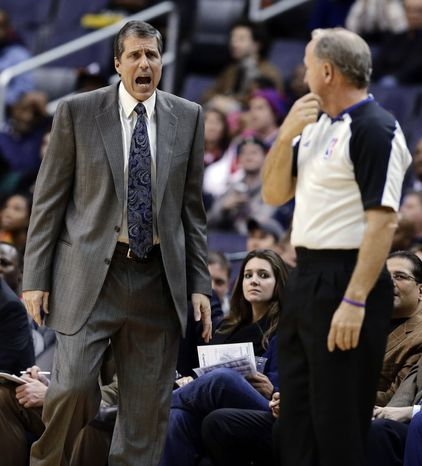 Washington Wizards coach Randy Wittman talks with an official in the first half of an NBA basketball game against the Indiana Pacers on Monday, Nov. 19, 2012, in Washington. The Pacers won 96-89. (AP Photo/Alex Brandon)