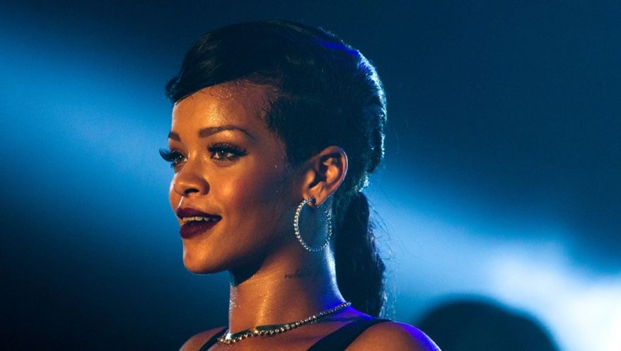 "Barbadian singer Rihanna performs during the fifth stop of her worldwide ""777"" tour at the E-Werk club in Berlin on Nov. 19, 2012. (Associated Press)"