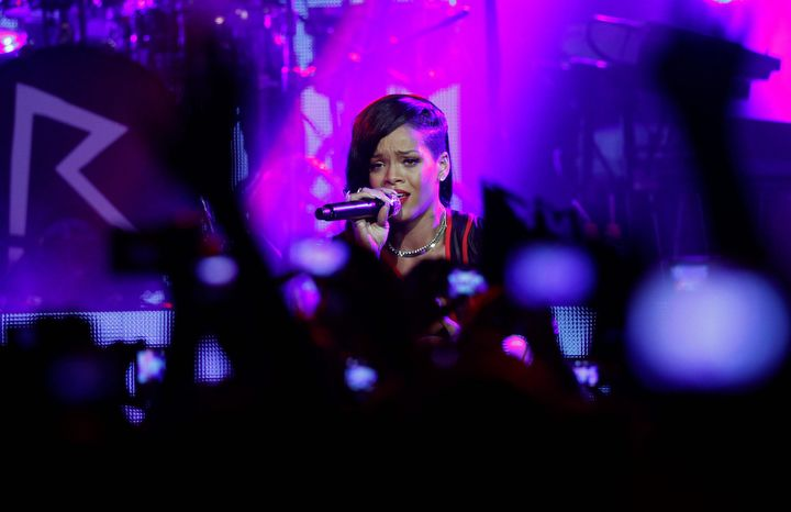 "Barbadian singer Rihanna performs during the first stop of her ""777"" worldwide tour at the Plaza Condesa in Mexico City on Nov. 14, 2012. (Associated Press)"