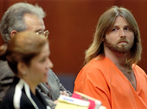 **FILE** Convicted murderer Glen Rogers (right) stares at public defender Joan Corces during a July 8, 1996, hearing in Tampa, Fla. (Associated Press)