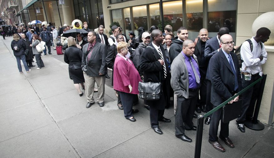 **FILE** Job seekers wait in line to see employers at a National Career Fairs' job fair in New York on Oct. 24, 2012. (Associated Press)