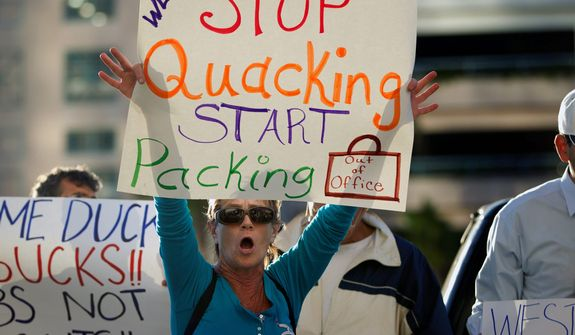**FILE** Linda McSpadden demands that Rep. Allen West, Florida Republican, stop his battle for his congressional seat, Florida's 18th District, outside the Palm Beach Circuit Court House in West Palm Beach, Fla. on Nov. 8, 2012. (Associated Press)