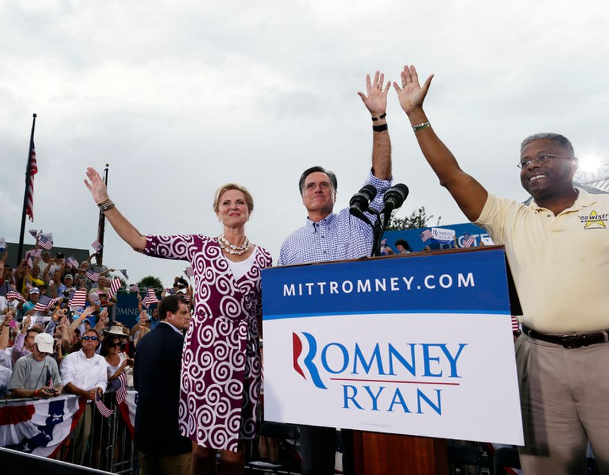 **FILE** Rep. Allen West (right), Florida Republican, campaigns with Republican presidential candidate Mitt Romney and Romney's wife, Ann, at Tradition Town Square in Port St. Lucie, Fla., on Oct. 7, 2012. (Associated Press)