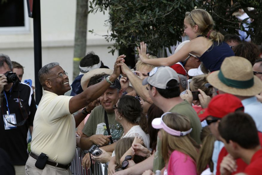 **FILE** Rep. Allen West (left), Florida Republican, greets the crowd before a campaign rally for Republican presidential candidate Mitt Romney, Sunday in Port St. Lucie, Fla., on Oct. 7, 2012. (Associated Press)