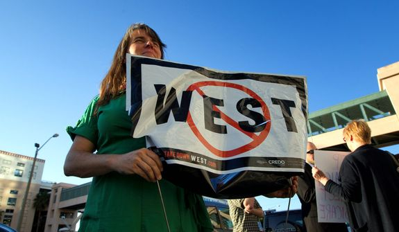**FILE** Cara Jennings joins a Nov. 8, 2012, demonstration outside the Palm Beach Circuit Court building in West Palm Beach, Fla., where people demanded Republican Rep. Allen West stop his battle to keep his congressional seat. (Associated Press)
