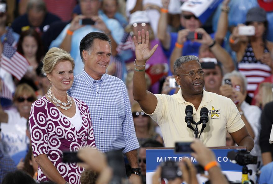 **FILE** Rep. Allen West (right), Florida Republican, waves before introducing Republican presidential candidate Mitt Romney (center) and Romney's wife, Ann, during a campaign rally in Port St. Lucie, Fla., on Oct. 7, 2012. (Associated Press)