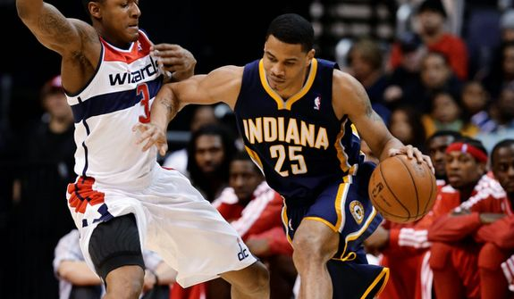 Washington Wizards forward Trevor Ariza guards Indiana Pacers forward Gerald Green during the first half of the Pacers' 96-89 road win on Nov. 19, 2012. (Associated Press)