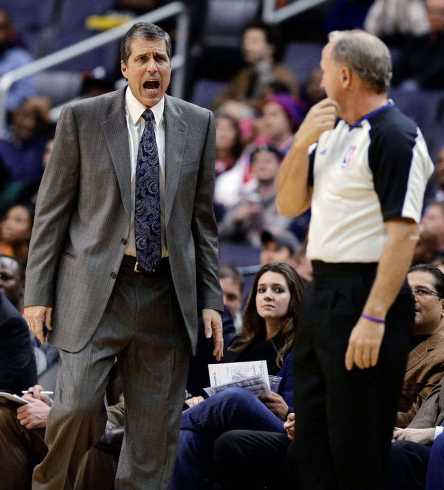Washington Wizards coach Randy Wittman talks with an official during the first half of the Pacers' 96-89 road win on Nov. 19, 2012. (Associated Press)