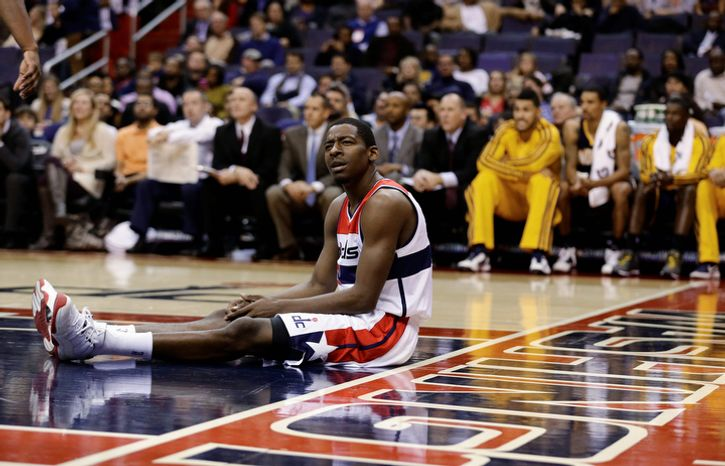 Washington Wizards guard Jordan Crawford pauses on the court during the first half of the Pacers' 96-89 road win on Nov. 19, 2012. (Associated Press)