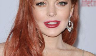 """Lindsay Lohan celebrated the premiere of """"Liz & Dick"""" on Tuesday, but arrived a little more than fashionably late. (Associated Press)"""