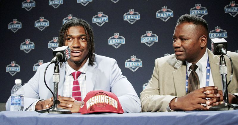 Robert Griffin III was joined by his father, Robert Griffin Jr., as he addressed members of the media after being drafted by the Redskins. Robert Jr. and wife Jacqueline instilled principles rooted in faith and family, which Robert III has carried with him into his NFL career. (Associated Press)