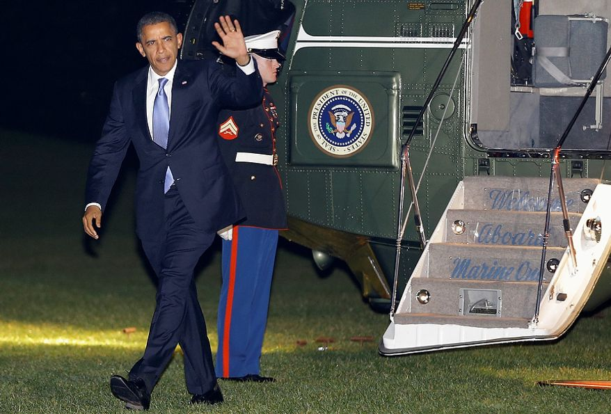 President Barack Obama returns from a trip to Thailand, Myanmar, and Cambodia, on the Marine One helicopter on the East Lawn of the White House in Washington in the early morning on Wednesday, Nov. 21, 2012. (AP Photo/Jacquelyn Martin)