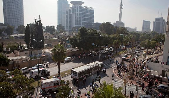 A destroyed bus is seen at the site of a bombing in Tel Aviv, Israel, Wednesday, Nov. 21, 2012. A bomb ripped through an Israeli bus near the nation's military headquarters in Tel Aviv on Wednesday, wounding several people, Israeli officials said. The blast came amid a weeklong Israeli offensive against Palestinian militants in Gaza.(AP Photo/Dan Balilty)