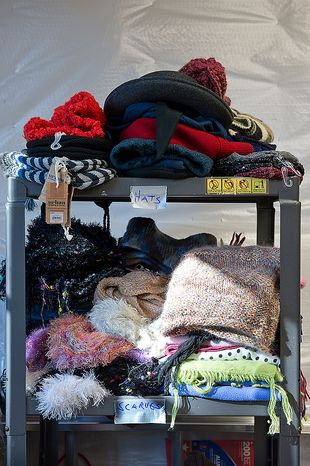 "Hats and scarves are just some of the donated items that the Audas family from Bethesda, Md. has collected as part of ""Project Keep Them Cozy,"" a project started by the two Audas children, Abbi, 12, and Andrew, 9, as a way to help Hurricane Sandy victims. The family plans to drive all of the donated items up to New Jersey, where they will spend Thanksgiving volunteering to help those families who lost everything in the storm. (Barbara L. Salisbury/The Washington Times)"