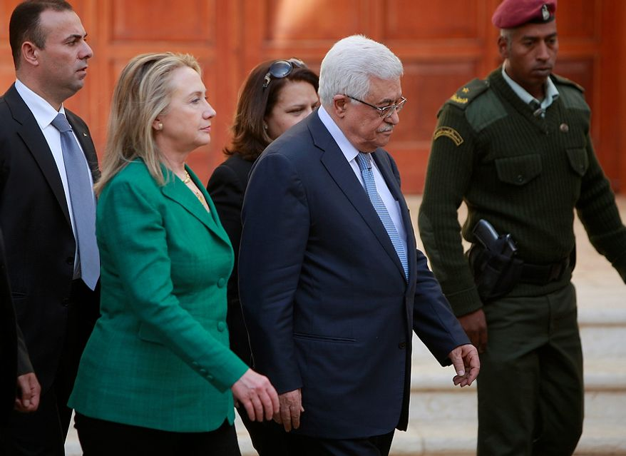 U.S. Secretary of State Hillary Rodham Clinton, left, and Palestinian President Mahmoud Abbas walk together following a meeting in the West Bank city of Ramallah, Wednesday, Nov. 21, 2012. Clinton will try on Wednesday to wring an elusive truce deal from Israel and Gaza's militant Hamas rulers after earlier efforts to end more than a week of fighting broke down amid a furious spasm of violence. (AP Photo/Majdi Mohammed)
