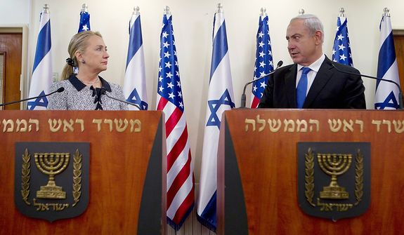 "Israel's Prime Minister Benjamin Netanyahu and U.S. Secretary of State Hillary Rodham Clinton deliver joint statements in Jerusalem, Tuesday, Nov. 20, 2012. A diplomatic push to end Israel's nearly weeklong offensive in the Gaza Strip gained momentum Tuesday, with Egypt's president predicting that airstrikes would soon end, the U.S. secretary of state racing to the region and Israel's prime minister saying his country would be a ""willing partner"" to a cease-fire with the Islamic militant group Hamas.(AP Photo/Baz Ratner, Pool)"
