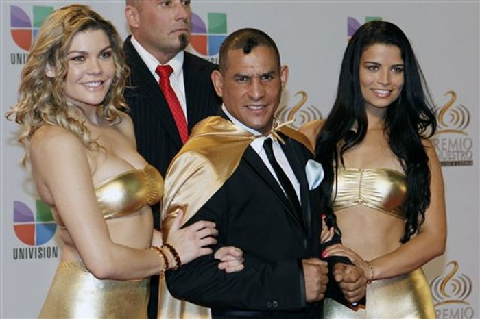 """**FILE** Former boxing champion Hector """"Macho"""" Camacho (center) poses for photographers at his arrival to the Premio Lo Nuestro Music Awards in Miami on Feb. 16, 2012. (Associated Press)"""