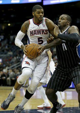 Atlanta Hawks small forward Josh Smith (5) plays against Orlando Magic power forward Glen Davis (11) in an NBA basketball game Monday, Nov. 19, 2012, in Atlanta. (AP Photo/David Goldman)