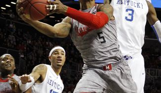 Nick Faust (shown in action against Kentucky) had his steadiest game yet, scoring 13 points and notching eight rebounds in Maryland's 83-74 win against Lafayette on Tuesday. (Associated Press)