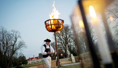 """** FILE ** The town crier, played by volunteer Stephen Fahy, prepares to shout out to announce a group of visitors during """"Christmas at Mount Vernon"""" at Mount Vernon in Alexandria, Va, Sunday, Dec. 4, 2011. (Rod Lamkey Jr/ The Washington Times)"""