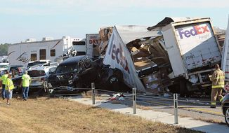 Cars and trucks are piled up on Interstate 10 in Southeast Texas on Thursday. The Texas Department of Public Safety says at least 80 people were injured in a pileup involving more than 100 vehicles. A man and a woman were killed. (Associated Press)