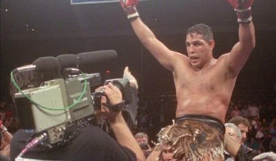 """** FILE ** This June 22, 1996, file photo shows Hector """"Macho"""" Camacho being lifted into the air after his unanimous decision over Roberto Duran in an IBC middleweight title fight at the Trump Taj Mahal Casino Resort in Atlantic City, N.J. (AP Photo/Donna Connor, File)"""