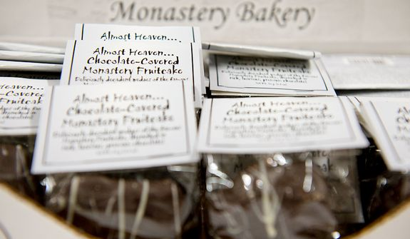 Slices of chocolate-covered fruitcake are packaged for sale at the Holy Cross Abbey in Berryville, Va. on Tuesday, Nov. 13, 2012. The monks spend January to September baking the fruitcakes, which they sell to support the day-to-day operations of the monastery. Christmastime is their busiest time of year in terms of orders; they generally ship out about 10,000 fruitcakes. (Barbara L. Salisbury/The Washington Times)