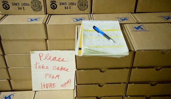 A note indicates where to get fruitcakes for shipping out in the shipping room at the Holy Cross Abbey in Berryville, Va. on Tuesday, Nov. 13, 2012. The monks at the abbey have been baking and selling fruitcakes since the 1980s to support their monastery. Their busiest time of year is Christmas, when they get about 10,000 orders. They bake from January to September in order to allow at least six weeks of aging before shipping the fruitcakes out. (Barbara L. Salisbury/The Washington Times)
