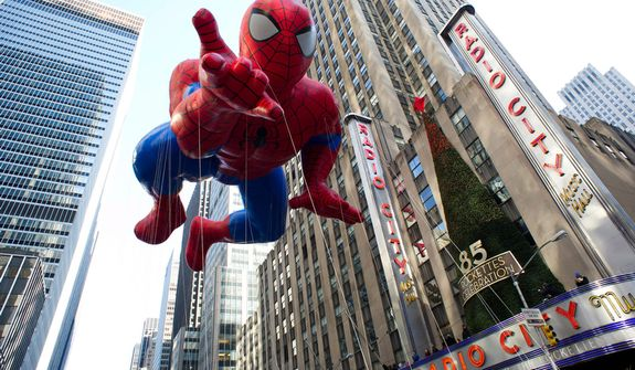 The Spider-Man balloon floats in the Macy's Thanksgiving Day Parade in New York in New York, Thursday, Nov. 22, 2012. The annual Macy's Thanksgiving Day Parade kicked off in New York on Thursday, putting a festive mood in the air in a city still coping with the aftermath of Superstorm Sandy.  (AP Photo/Charles Sykes)