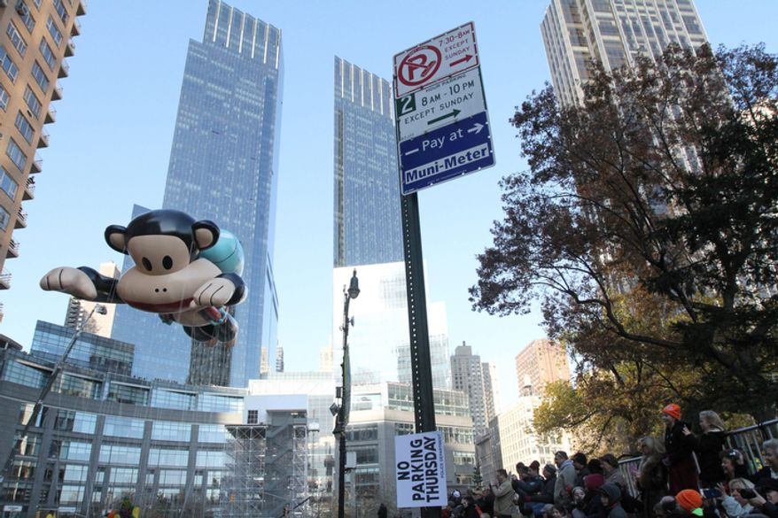 The Julius balloon moves through Columbus Circle as it participates in the 86th Annual Macy's Thanksgiving Day Parade Thursday Nov. 22, 2012, in New York. The annual Macy's Thanksgiving Day Parade put a festive mood in the air in a city still coping with the aftermath of Superstorm Sandy.  (AP Photo/Tina Fineberg)
