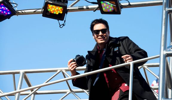 Jimmy Fallon rides a float in the Macy's Thanksgiving Day Parade in New York, Thursday, Nov. 22, 2012. The annual Macy's Thanksgiving Day Parade put a festive mood in the air in a city still coping with the aftermath of Superstorm Sandy (AP Photo/Charles Sykes)