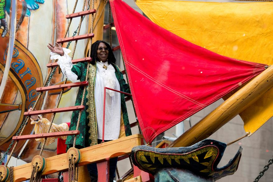 Whoopi Goldberg rides a float in the Macy's Thanksgiving Day Parade in New York, Thursday, Nov. 22, 2012. The American harvest holiday came as portions of the Northeast were still coping with Superstorm Sandy's havoc, and volunteers planned to serve thousands of turkey dinners to people it left homeless or struggling. (AP Photo/Charles Sykes)