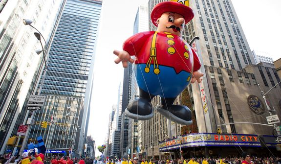 The Harold the Fireman balloon floats in the Macy's Thanksgiving Day Parade in New York in New York, Thursday, Nov. 22, 2012. The annual Macy's Thanksgiving Day Parade kicked off in New York on Thursday, putting a festive mood in the air in a city still coping with the aftermath of Superstorm Sandy.  (AP Photo/Charles Sykes)
