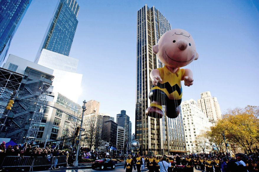 The Charlie Brown balloon floats in the Macy's Thanksgiving Day Parade in New York, Thursday, Nov. 22, 2012. The annual Macy's Thanksgiving Day Parade put a festive mood in the air in a city still coping with the aftermath of Superstorm Sandy (AP Photo/Charles Sykes)