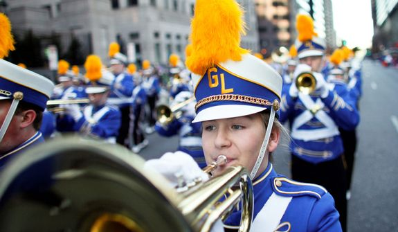 Members of the Gahanna Lincoln Marching Band play during the 93rd annual Thanksgiving day parade, Thursday Nov. 22, 2012, in Philadelphia.  New York, Chicago, and Detroit are also among the cities hosting holiday parades. (AP Photo/ Joseph Kaczmarek)