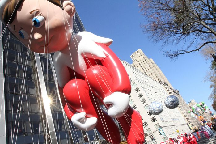 The Elf on the Shelf balloon makes it's way through New York's Columbus Circle during the 86th Annual Macy's Thanksgiving Day Parade Thursday Nov. 22, 2012, in New York. The annual Macy's Thanksgiving Day Parade put a festive mood in the air in a city still coping with the aftermath of Superstorm Sandy.  (AP Photo/Tina Fineberg)