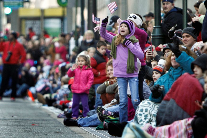 Spectators cheer during the 93rd annual Thanksgiving day parade, Thursday Nov. 22, 2012, in Philadelphia. New York, Chicago, and Detroit are also among the cities hosting holiday parades. (AP Photo/ Joseph Kaczmarek)