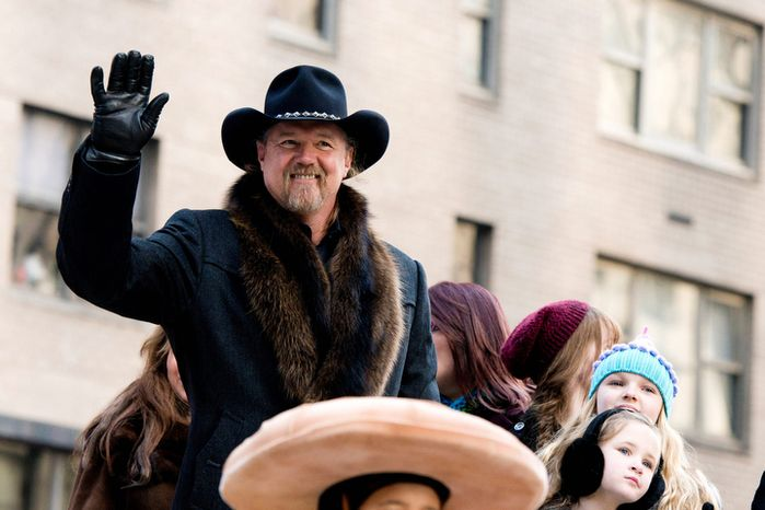 Trace Adkins rides a float in the Macy's Thanksgiving Day Parade in New York, Thursday, Nov. 22, 2012. The American harvest holiday came as portions of the Northeast were still coping with the wake of Superstorm Sandy, and volunteers planned to serve thousands of turkey dinners to people it left homeless or struggling. (AP Photo/Charles Sykes)
