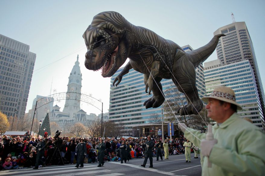 The T-Rex balloon make its way down 16th Street in view of City Hall during the 93rd annual Thanksgiving day parade, Thursday Nov. 22, 2012, in Philadelphia.  (AP Photo/ Joseph Kaczmarek)