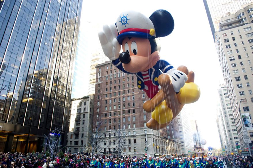 The Sailor Mickey balloon floats in the Macy's Thanksgiving Day Parade in New York, Thursday, Nov. 22, 2012. . The annual Macy's Thanksgiving Day Parade put a festive mood in the air in a city still coping with the aftermath of Superstorm Sandy (AP Photo/Charles Sykes)