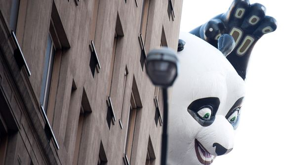The Kung Fu Panda balloon floats in the Macy's Thanksgiving Day Parade in New York, Thursday, Nov. 22, 2012. The American harvest holiday came as portions of the Northeast were still coping with the wake of Superstorm Sandy, and volunteers planned to serve thousands of turkey dinners to people it left homeless or struggling. (AP Photo/Charles Sykes)