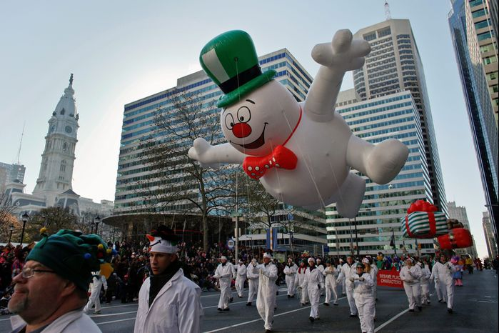 The Frosty the Snowman balloon make its way down 16th Street in view of City Hall during the 93rd annual Thanksgiving day parade, Thursday Nov. 22, 2012, in Philadelphia .New York, Chicago, and Detroit are also among the cities hosting holiday parades. (AP Photo/Joseph Kaczmarek)