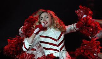 The American singer Madonna performs in concert in St. Petersburg on Thursday, Aug. 9, 2012. (AP Photo/Olga Maltseva)